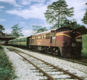 Locomotive 20113 plus train near Sentul Junction at Kuala Lumpur, March 1979