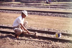 The man with a hammer. A lovely picture; an extra nail will do the job, Thai style maintenance but not durable for ever.